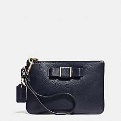 COACH SMALL WRISTLET WITH BOW IN CROSSGRAIN LEATHER - LIGHT GOLD/MIDNIGHT - F52629