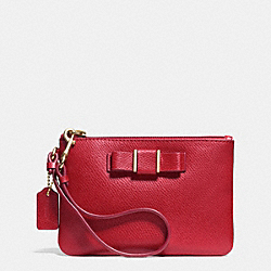 COACH SMALL WRISTLET WITH BOW IN CROSSGRAIN LEATHER - LIGHT GOLD/RED - F52629
