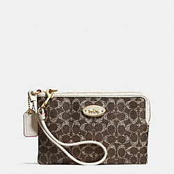 COACH CORNER ZIP WRISTLET IN EMBOSSED SIGNATURE - LIDRY - F53009