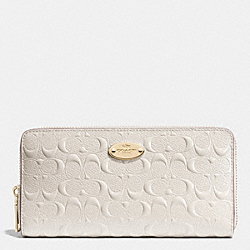 COACH ACCORDION ZIP WALLET IN SIGNATURE DEBOSSED PATENT LEATHER - LIGHT GOLD/CHALK - F53126