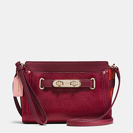 COACH COACH SWAGGER WRISTLET IN COLORBLOCK PEBBLE LEATHER - LIGHT GOLD/BLACK CHERRY - f53479