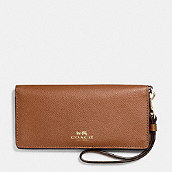 COACH SLIM WALLET IN RAINBOW COLORBLOCK LEATHER - IMITATION GOLD/SADDLE MULTI - F53894