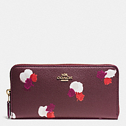 COACH ACCORDION ZIP WALLET IN FIELD FLORA PRINT COATED CANVAS - IMITATION GOLD/BURGUNDY MULTI - F54017