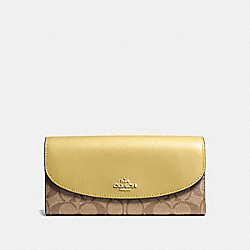 SLIM ENVELOPE WALLET IN SIGNATURE CANVAS - KHAKI/SUNFLOWER/GOLD - COACH F54022
