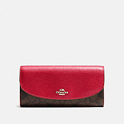 COACH SLIM ENVELOPE WALLET IN SIGNATURE - IMITATION GOLD/BROWN TRUE RED - F54022