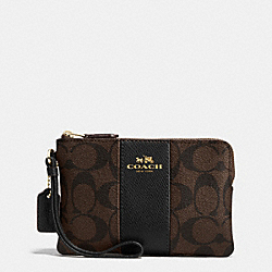 COACH CORNER ZIP WRISTLET IN SIGNATURE COATED CANVAS WITH LEATHER STRIPE - IMITATION GOLD/BROWN/BLACK - F54629