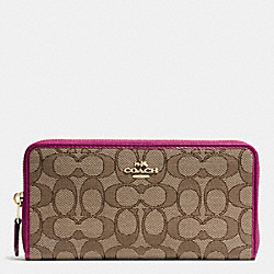 COACH ACCORDION ZIP WALLET IN OUTLINE SIGNATURE - IMITATION GOLD/KHAKI/FUCHSIA - F54633