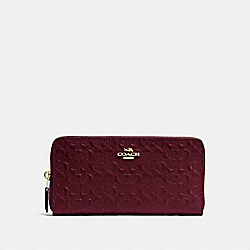 COACH ACCORDION ZIP WALLET IN SIGNATURE DEBOSSED PATENT LEATHER - IMITATION GOLD/OXBLOOD 1 - F54805