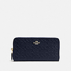 COACH ACCORDION ZIP WALLET IN SIGNATURE DEBOSSED PATENT LEATHER - IMITATION GOLD/MIDNIGHT - F54805