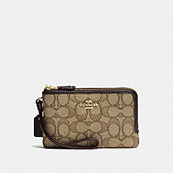 DOUBLE CORNER ZIP WRISTLET IN SIGNATURE JACQUARD - LI/KHAKI/BROWN - COACH F55361
