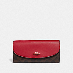 LUNAR NEW YEAR SLIM ENVELOPE WALLET IN COLORBLOCK SIGNATURE CANVAS - BROWN BLACK/PINK MULTI/IMITATION GOLD - COACH F55616