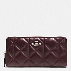 COACH ACCORDION ZIP WALLET IN QUILTED LEATHER - IMITATION GOLD/OXBLOOD 1 - F55672