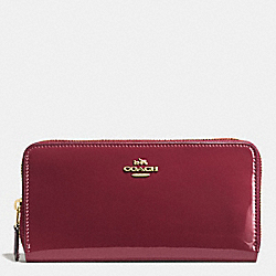 COACH BOXED ACCORDION ZIP WALLET IN SMOOTH PATENT LEATHER - IMITATION GOLD/BURGUNDY - F55734