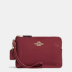 COACH BOXED CORNER ZIP WRISTLET IN SMOOTH PATENT LEATHER - IMITATION GOLD/BURGUNDY - F55739