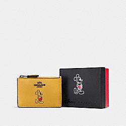 BOXED MICKEY MINI SKINNY ID CASE - DK/CANARY - COACH F56265