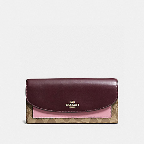 COACH SLIM ENVELOPE WALLET IN COLORBLOCK SIGNATURE CANVAS - KHAKI/OXBLOOD MULTI/LIGHT GOLD - f56494