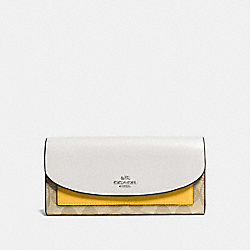 COACH SLIM ENVELOPE WALLET IN COLORBLOCK SIGNATURE COATED CANVAS - SILVER/LT KHAKI - F56494