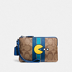 CORNER ZIP WRISTLET IN SIGNATURE CANVAS WITH PAC MAN - KHAKI/DENIM/BLACK ANTIQUE NICKEL - COACH F56715