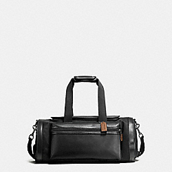 TERRAIN GYM BAG IN PERFORATED MIXED MATERIALS - BLACK/DARK SADDLE - COACH F56875