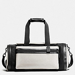 COACH TERRAIN GYM BAG IN PERFORATED MIXED MATERIALS - CHALK/BLACK - F56875