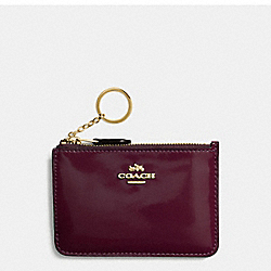 COACH KEY POUCH WITH GUSSET IN PATENT LEATHER - IMITATION GOLD/OXBLOOD 1 - F57310