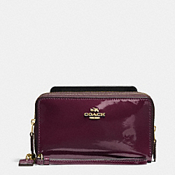 COACH DOUBLE ZIP PHONE WALLET IN PATENT LEATHER - IMITATION GOLD/OXBLOOD 1 - F57314
