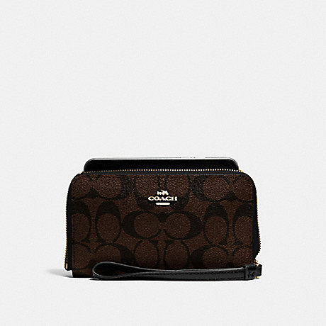 COACH PHONE WALLET IN SIGNATURE CANVAS - BROWN/BLACK/LIGHT GOLD - F57468