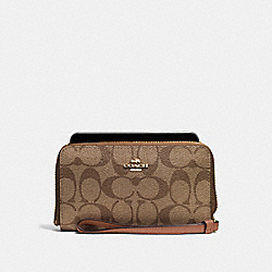 COACH PHONE WALLET IN SIGNATURE COATED CANVAS - IMITATION GOLD/KHAKI/SADDLE - F57468