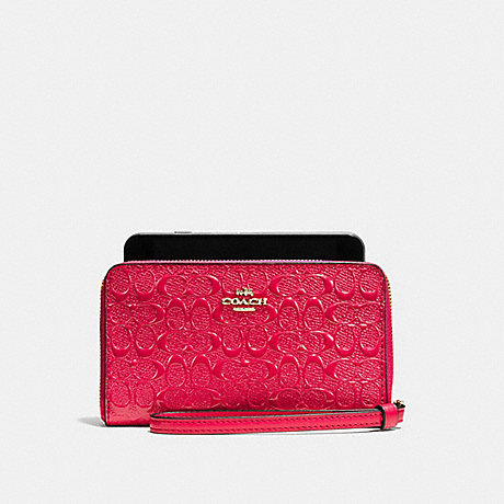 COACH PHONE WALLET IN SIGNATURE DEBOSSED PATENT LEATHER - IMITATION GOLD/BRIGHT PINK - f57469