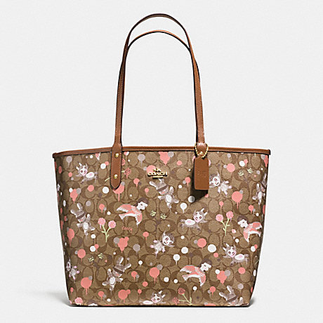 COACH f57917 BASEMAN X COACH SECRET ORDER REVERISBLE TOTE IN SIGNATURE COATED CANVAS IMITATION GOLD/KHAKI PINK MULTI