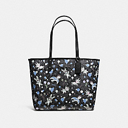 COACH BASEMAN X COACH SECRET ORDER REVERISBLE TOTE IN SIGNATURE COATED CANVAS - CHARCOAL BLUE MULTI - F57917