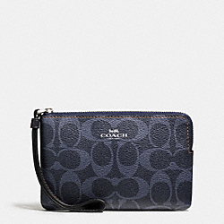 COACH CORNER ZIP WRISTLET IN DENIM SIGNATURE - SILVER/DENIM - F57996