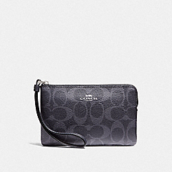 CORNER ZIP WRISTLET IN SIGNATURE CANVAS - DENIM MIDNIGHT/SILVER - COACH F57996