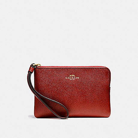COACH CORNER ZIP WRISTLET - LIGHT GOLD/DARK RED - f58032