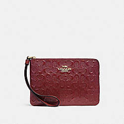 CORNER ZIP WRISTLET IN SIGNATURE LEATHER - CHERRY /LIGHT GOLD - COACH F58034