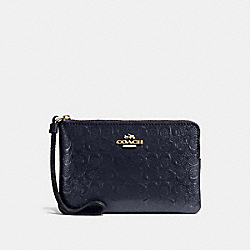 COACH CORNER ZIP WRISTLET IN SIGNATURE DEBOSSED PATENT LEATHER - IMITATION GOLD/MIDNIGHT - F58034