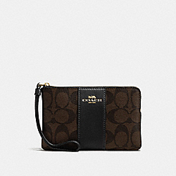 COACH CORNER ZIP WRISTLET IN SIGNATURE COATED CANVAS WITH LEATHER STRIPE - IMITATION GOLD/BROWN/BLACK - F58035