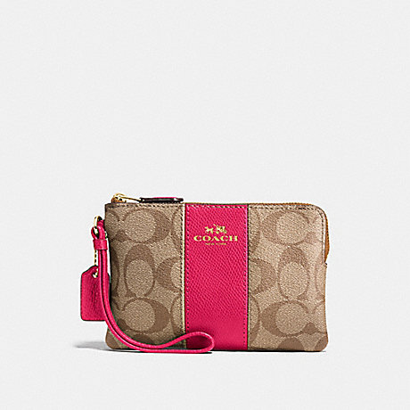 COACH CORNER ZIP WRISTLET IN SIGNATURE COATED CANVAS WITH LEATHER STRIPE - IMITATION GOLD/KHAKI/BRIGHT PINK - f58035