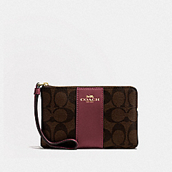 CORNER ZIP WRISTLET IN SIGNATURE CANVAS - IM/BROWN/WINE - COACH F58035