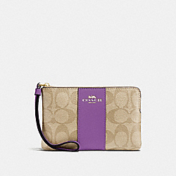 CORNER ZIP WRISTLET IN SIGNATURE CANVAS - LIGHT KHAKI/PRIMROSE/IMITATION GOLD - COACH F58035