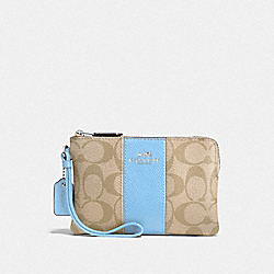 CORNER ZIP WRISTLET IN SIGNATURE COATED CANVAS WITH LEATHER STRIPE - SILVER/LIGHT KHAKI - COACH F58035