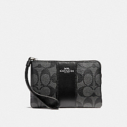 COACH CORNER ZIP WRISTLET IN SIGNATURE CANVAS - BLACK SMOKE/BLACK/SILVER - F58035