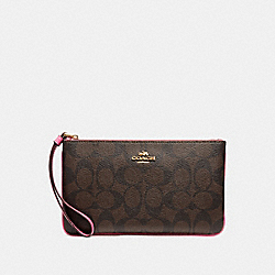 COACH LARGE WRISTLET IN SIGNATURE CANVAS - BROWN /PINK/LIGHT GOLD - F58695
