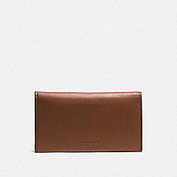 COACH UNIVERSAL PHONE CASE IN SPORT CALF LEATHER - DARK SADDLE - F63646
