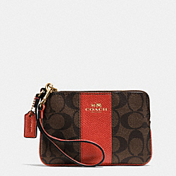 COACH CORNER ZIP WRISTLET IN SIGNATURE COATED CANVAS WITH LEATHER - IMITATION GOLD/BROWN/CARMINE - F64233