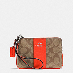 COACH CORNER ZIP WRISTLET IN SIGNATURE COATED CANVAS WITH LEATHER - SILVER/KHAKI/ORANGE - F64233