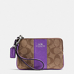 COACH CORNER ZIP WRISTLET IN SIGNATURE COATED CANVAS WITH LEATHER - SILVER/KHAKI/PURPLE IRIS - F64233