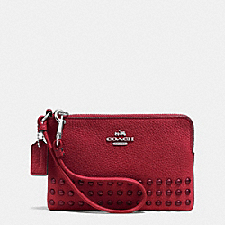 COACH CORNER ZIP WRISTLET IN POLISHED PEBBLE LEATHER WITH LACQUER RIVETS - SILVER/RED CURRANT - F64252