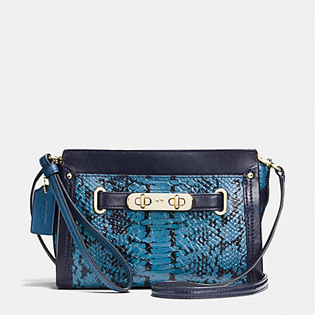 COACH COACH SWAGGER WRISTLET IN COLORBLOCK EXOTIC EMBOSSED LEATHER - LIGHT GOLD/NAVY - f64731
