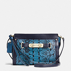 COACH SWAGGER WRISTLET IN COLORBLOCK EXOTIC EMBOSSED LEATHER - LIGHT GOLD/NAVY - COACH F64731